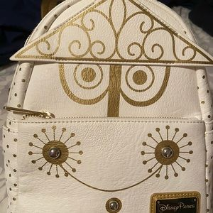 """Disney Loungefly """"It's a Small World"""" backpack."""
